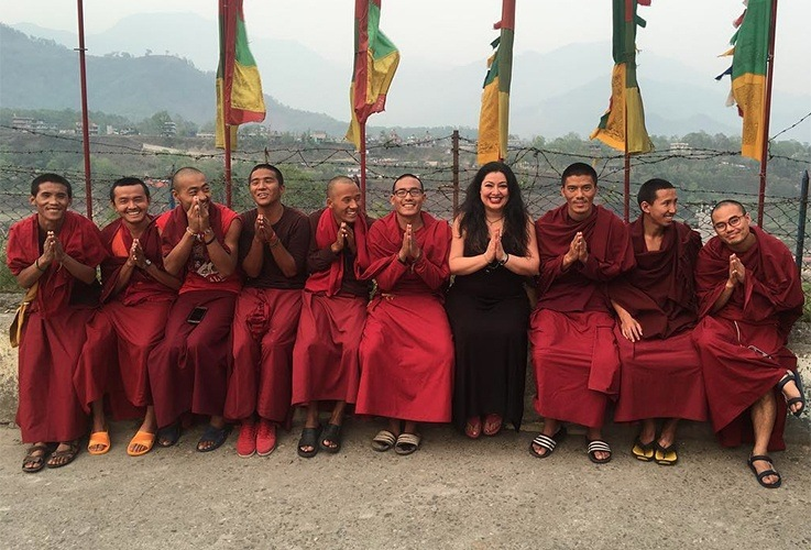 Dr. Naini posing with budhist monks