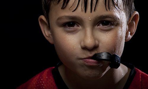 Child holding mouthguard