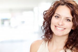 woman smiling brunette perfect teeth